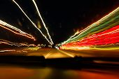 Drunken driving concept. Speedy night driving. Sleepy driver looking on night road. Drugs and alcohol effect. Blurry and blending road during high speed trip. poster
