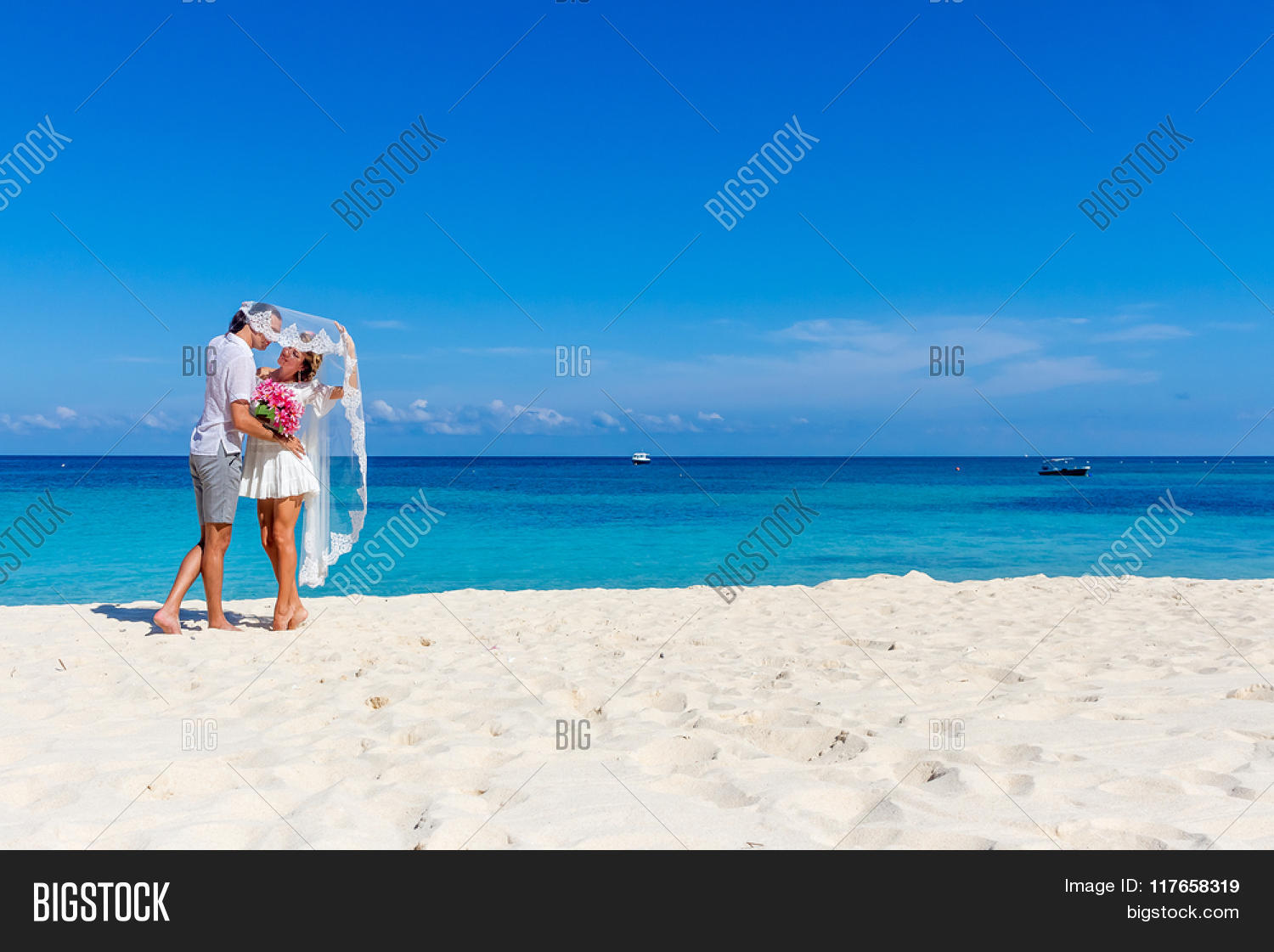 1f9919dbc8 outdoor portrait of young happy couple on wedding day, outdoor beach wedding  on tropical beach