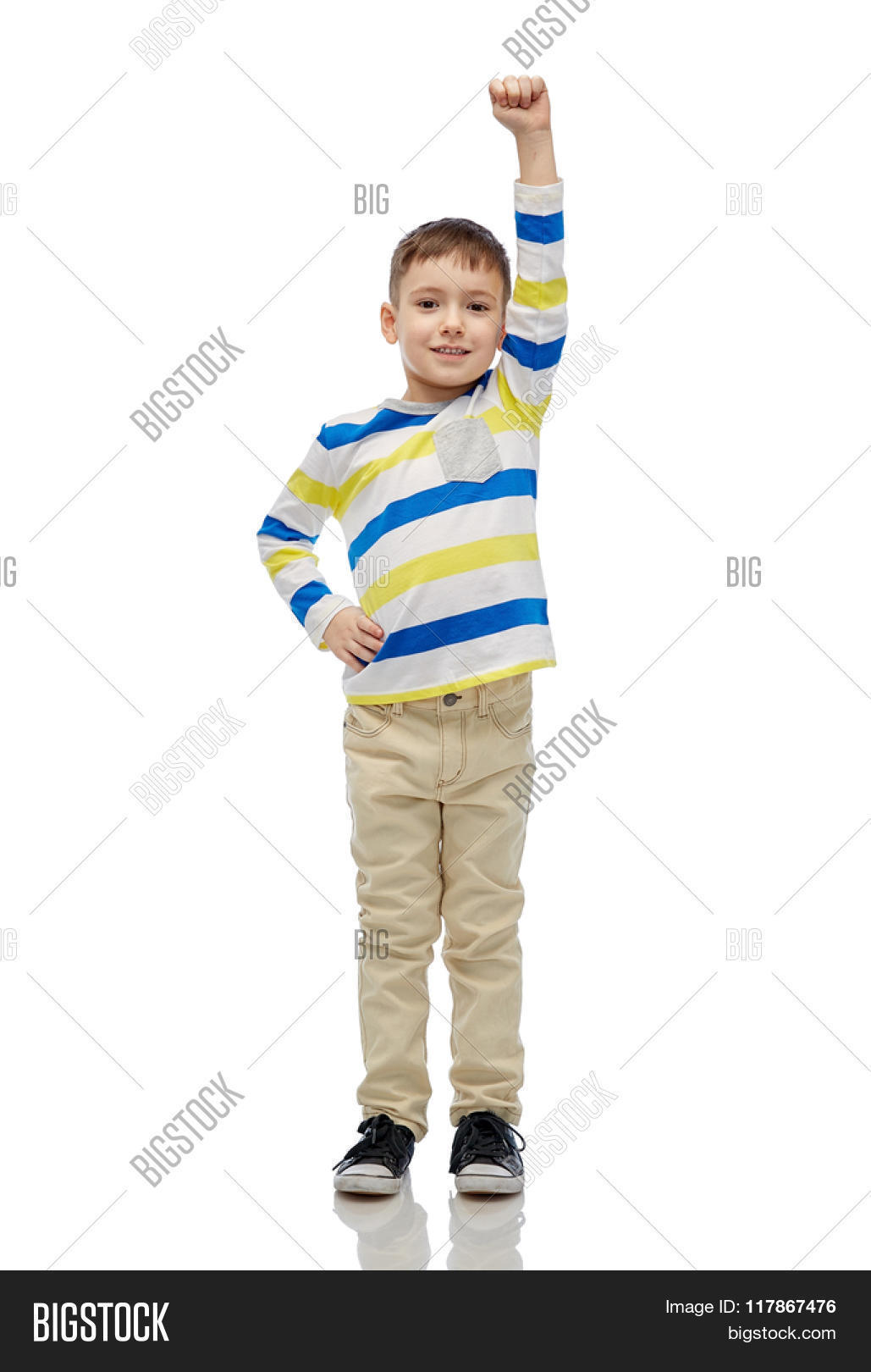 711365bdc4bf9 childhood, power, gesture and people concept - happy smiling little boy  with raised hand