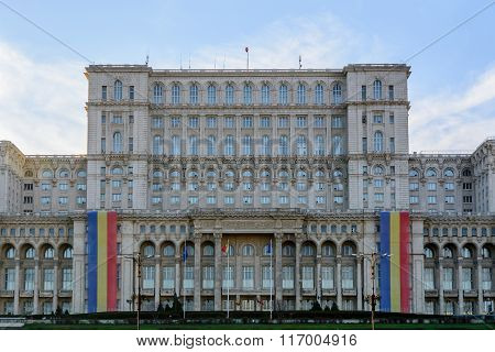 Bucharest Romania - 1st December: Casa Poporului on December 1 2015 in Bucharest. Central frame of the worlds largest civilian building the most expensive administrative building on Romanian national day. poster