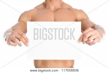 Bodybuilding And Advertising: A Nice Strong Bodybuilder Holding A Paper White Blank Card Isolated On
