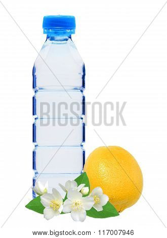 Blue bottle with water jasmine flowers and fresh yellow lemon isolated on white background