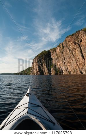 Kayaking at Bon Echo park area with the three hundred foot cliff in the background