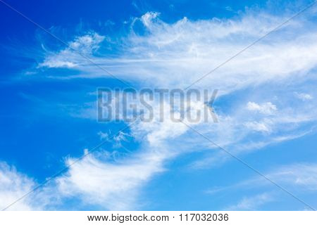Vibrant vacation summer background with idyllic white fluffy unusual shape clouds