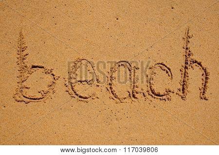 Beach Sign Written On Sand