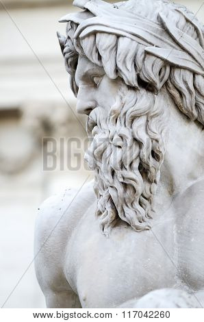 Statue of the god Zeus in Bernini's Fountain of the Four Rivers in the Piazza Navona Rome - detail of the allegorical Ganges figure