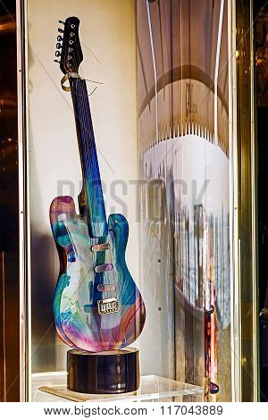 Glass Guitar Displayed In A Shop Window