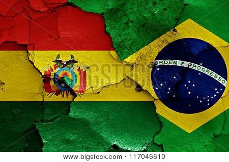 Flags Of Bolivia And Brazil Painted On Cracked Wall