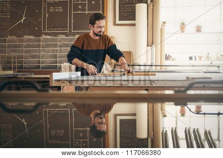 Skilled framer and craftsman at work in his studio