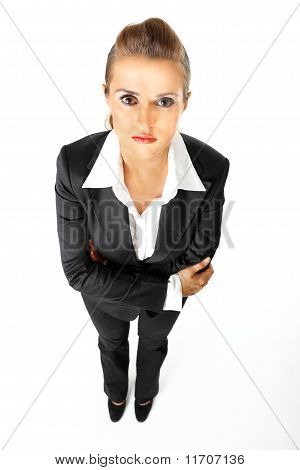 Full length portrait of serious modern business woman with crossed arms on chest isolated on white