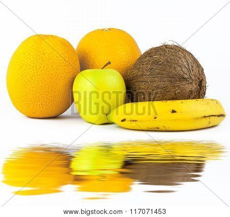 Still life with fruits on white: banana, orange, apple, coconut