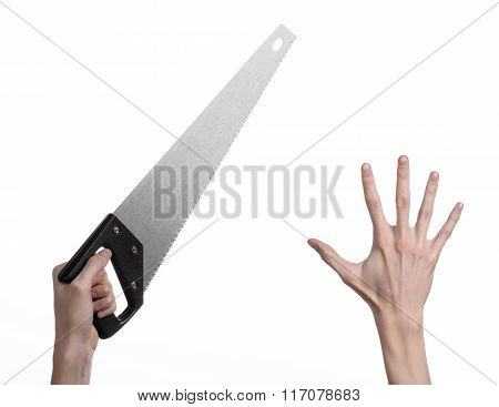 Construction Topic: Hand Holding A Saw With A Black Pen On A White Background Isolated