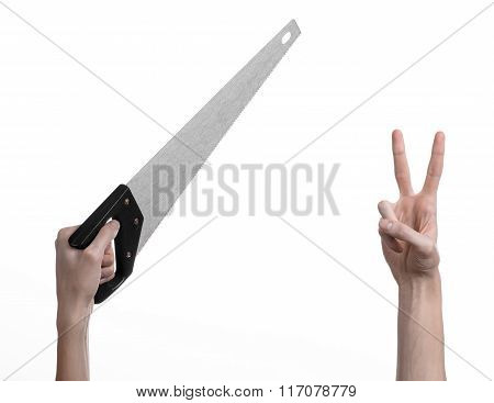 Hand holding a saw on a white background in studio
