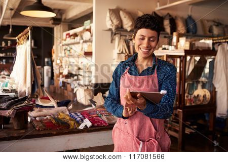 Female Owner Of Gift Store With Digital Tablet