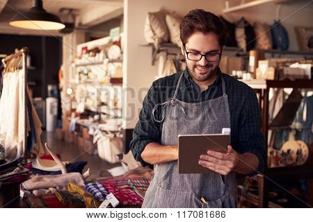 Male Owner Of Gift Store With Digital Tablet