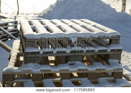 Box Pallets Covered In Snow