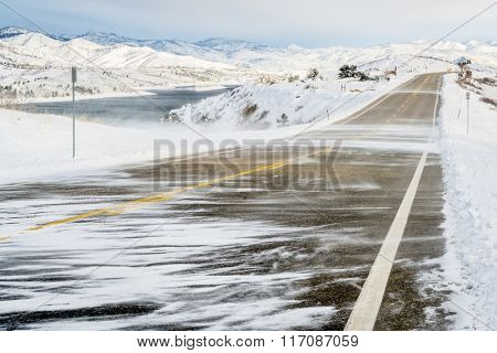 snow blowing wind over a road at foothills in northern Colorado near Fort Collins
