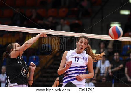 KAPOSVAR, HUNGARY - JANUARY 17: Ingrid Duduka (black 12) in action at the Hungarian I. League volleyball game Kaposvar (black) vs Ujpest (white), January 17, 2016 in Kaposvar, Hungary.