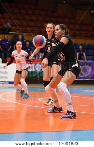 KAPOSVAR, HUNGARY - JANUARY 17: Kitti Szombathelyi (with ball) in action at the Hungarian I. League volleyball game Kaposvar (black) vs Ujpest (white), January 17, 2016 in Kaposvar, Hungary.