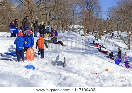 Children sledding in snow after storm