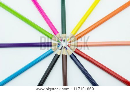 Radius From Multicolored Pencils Isolated On White Background.