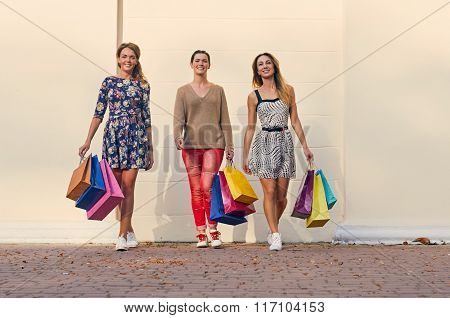 three Women with Shopping Bags on walk