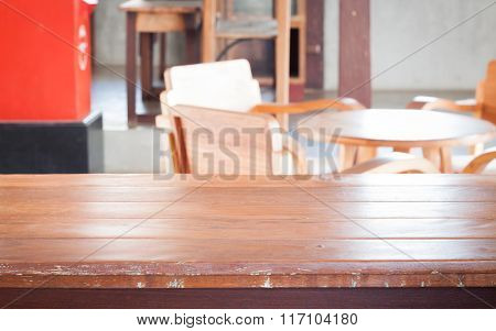 Empty Wooden Table In Coffee Shop