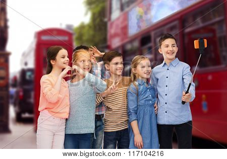 kids taking selfie by smartphone over london city