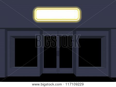 Night Shop. Convenience Store. Storefront At Night. Empty Black Counters. Shining Sign On Facade Of