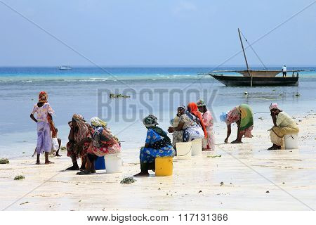 African Women In Traditional Dress On The Beach