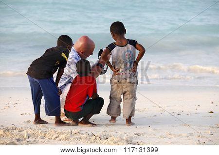 White Man With African Children