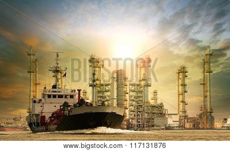 petroleum lpg gas container ship and oil refinery plant industry estate behind use for petrochemical