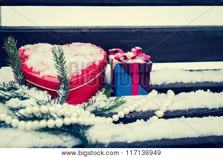 A Gift Box, White Pearl Necklace, Red Heart Shaped Tin Box With A Fragment Of A Pine-tree Branch
