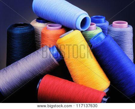 Multi colored textile yarn cones