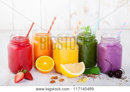 Smoothies, juices, beverages, drinks variety with fresh fruits and berries on a white wooden background. poster