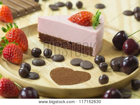 selective focus of strawberry chocolate cheese cakeon wood background with strawberry and chocolate poster