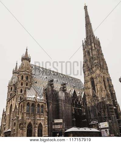 VIENNA AUSTRIA - 5TH JANUARY 2016: A low view of St. Stephen's Cathedral (Stephansdom) at Stephansplatz in Vienna during the winter. Snow can be seen on the building.