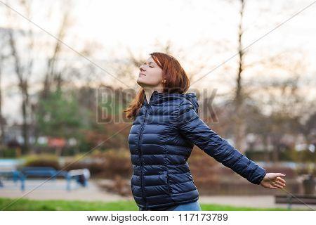 Young woman breathing fresh air before a run