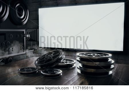 Old Movie Camera And Film Cartridge On A Wooden Table And A Blank Movie Screen, Mock Up