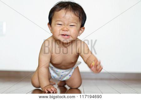 Crawling Japanese baby boy (0 year old)
