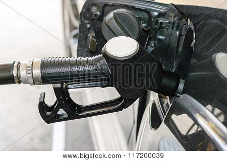 Fuel Nozzle Pay For Fuel And Benzyl.