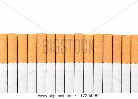 Row Of Cigarettes On White Background