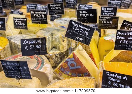 Florence, Italy - September 18, 2015: Various kinds of cheese with price tags on the market in Florence, Italy.