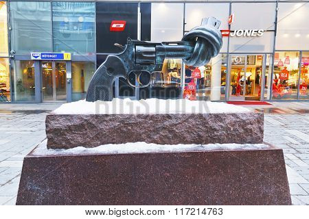 STOCKHOLM SWEDEN - JANUARY 5 2011: Non-Violence statue of twisted gun in winter Stockholm. Stockholm is the capital of Sweden and the most populous city in the Nordic region.