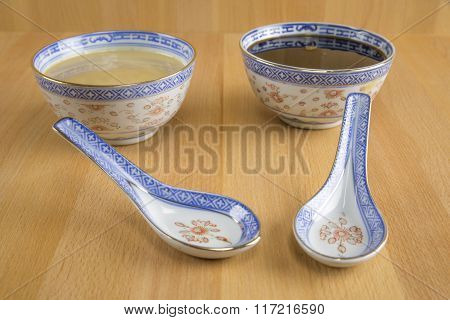 Tahini (sesame paste) and Molasses in porcelain bowl with porcelain spoon.
