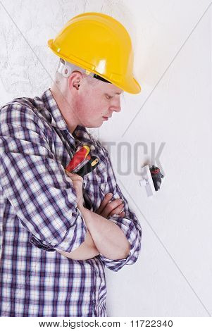 Electrician Fitting Light Switch