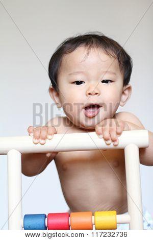 Japanese baby boy pushing a cart (0 year old)