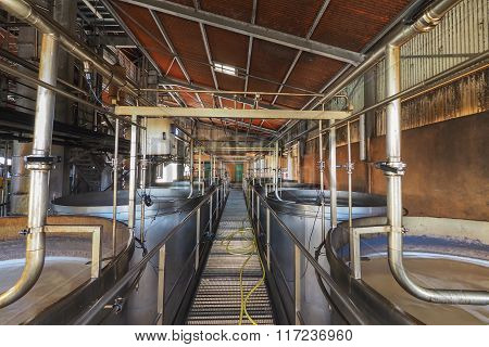 Capesterre, Marie Galante, Guadeloupe, 1st May 2015: Interior view of a rum plant in Marie Galante Caribbean with brewing tanks and pipes to let sugar juice fermentarion.
