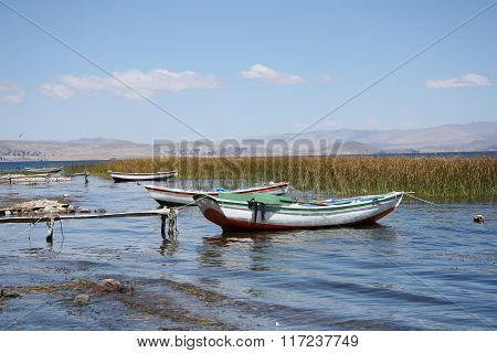 Boats on the reed shore of Titicaca lake in Bolivia