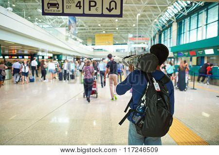 ROME, ITALY - AUGUST 16, 2015: passenger move oversize laggage in Fiumicino Airport. Fiumicino - Leonardo da Vinci International Airport is a major international airport in Rome, Italy